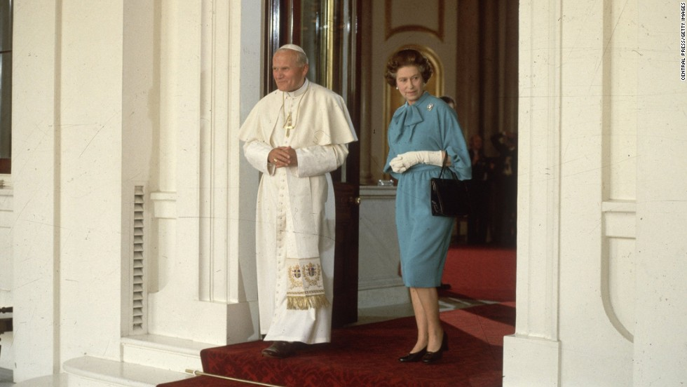 Pope John Paul II walks with the Queen at London's Buckingham Palace in May 1982.