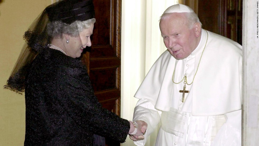 The Queen shakes hands with Pope John Paul II at the Pope's private office in October 2000.