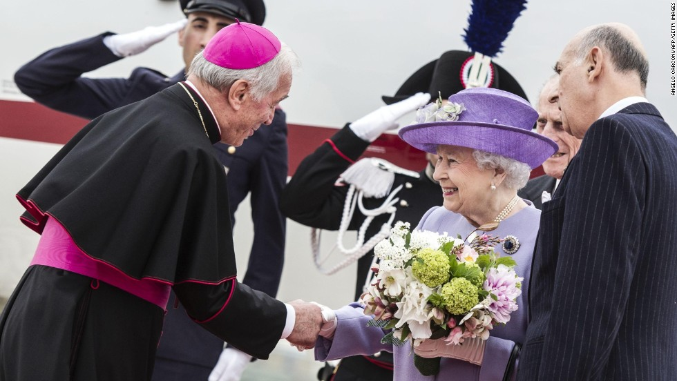 The Queen is welcomed by Archbishop Francesco Canalini at the Ciampino airport near Rome on April 3.