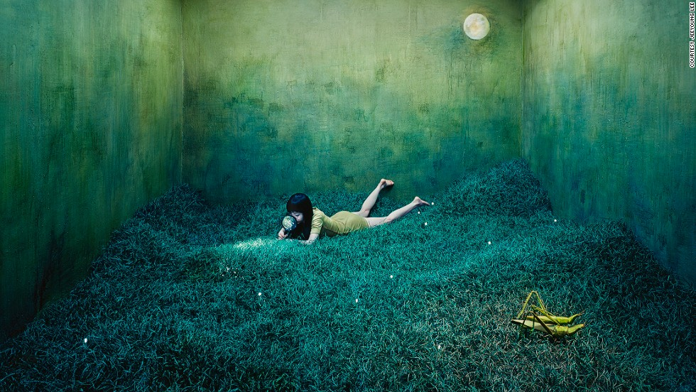 "Korean artist JeeYoung Lee creates worlds of surreal beauty and mystery in her tiny 3 meter x 6 meter studio in the Mangwon-dong neighborhood of Seoul. The 30-year-old documents her dreams, memories, and emotions by building thematic sets, and photographing herself as a character in their narrative. The otherworldly images, which were recently exhibited at the <a href=""http://www.opiomgallery.com/fr/artistes/oeuvresphotographe/17/jeeyoung-lee"" target=""_blank"">Opiom Gallery</a> in France, portray a tangible representation of the artist's imagination, and make it hard to believe that she builds the scenery herself, and doesn't use Photoshop.<br /><br /><em>Treasure hunt</em><br /><br />It took Lee three months to create this magical nocturnal landscape. The grass is made of craft wire, and every single piece is connected to a mesh screen. The artist was inspired by childhood memories of holidays spent at her grandparents' farm in the countryside, where after nightfall she would see scores of fireflies lit up against the dark shrubbery: ""To me they looked like they were on a treasure hunt,"" she explains, ""and I used that as a metaphor to show that finding your ideal is as difficult as searching for a needle in a grassy field."" The scene is set at night to emphasize the difficulty of the task.<br /><br /><em>Interview by </em><a href=""https://twitter.com/M_Veselinovic"" target=""_blank""><em><strong>Milena Veselinovic </em></strong></a>"
