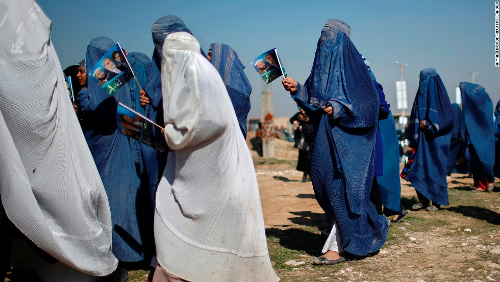 Supporters of Afghan presidential candidate Abdullah Abdullah arrive to attend an election rally in Mazar-i-Sharif, Afghanistan, on Friday, March 28.