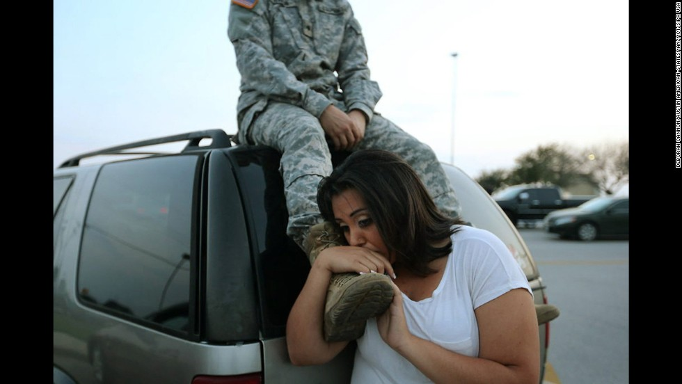 "Luci Hamlin and her husband, Spc. Timothy Hamlin, wait to get back to their home in Fort Hood, Texas, after a shooting at the U.S. Army post on Wednesday, April 2. Spc. Ivan Lopez, <a href=""http://www.cnn.com/2014/04/02/us/fort-hood-shooter-profile/index.html"">a 34-year-old Iraq war veteran</a>, opened fire Wednesday, killing three people and injuring 16 others before killing himself, authorities said."