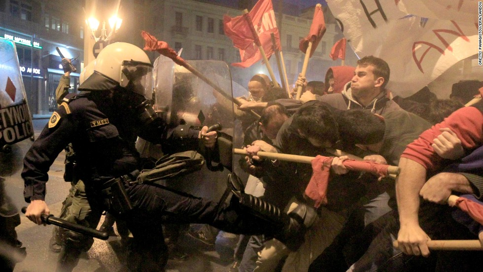 People in Athens, Greece, clash with riot police Tuesday, April 1, during a protest against the Eurogroup and Ecofin meetings.
