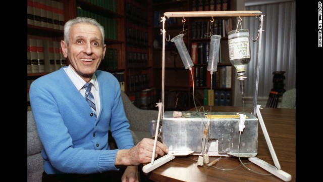 "Jack Kevorkian poses with his Thanatron suicide machine"" in February 1991."