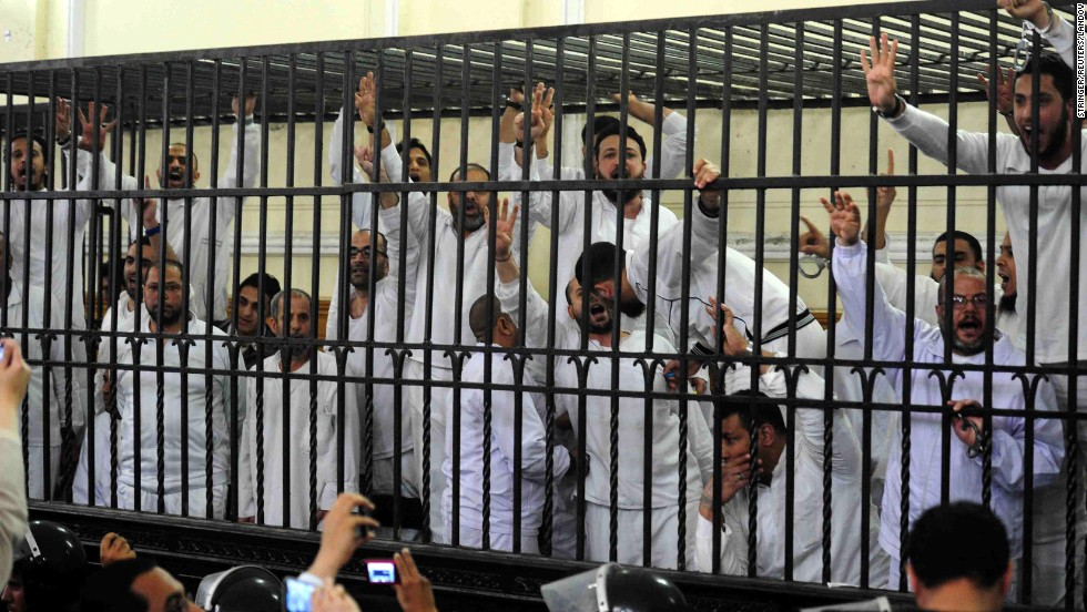 Supporters of former Egyptian President Mohamed Morsy react in an Alexandria, Egypt, courtroom after two of their fellow supporters were sentenced to death on Saturday, March 29. All of the supporters have been charged in connection with violence that broke out in Alexandria last year.