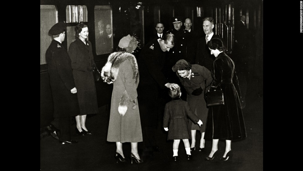 The future Queen Elizabeth II and her husband, the Duke of Edinburgh, greet their son Charles at Euston Station in London after returning from Canada in November 1951.
