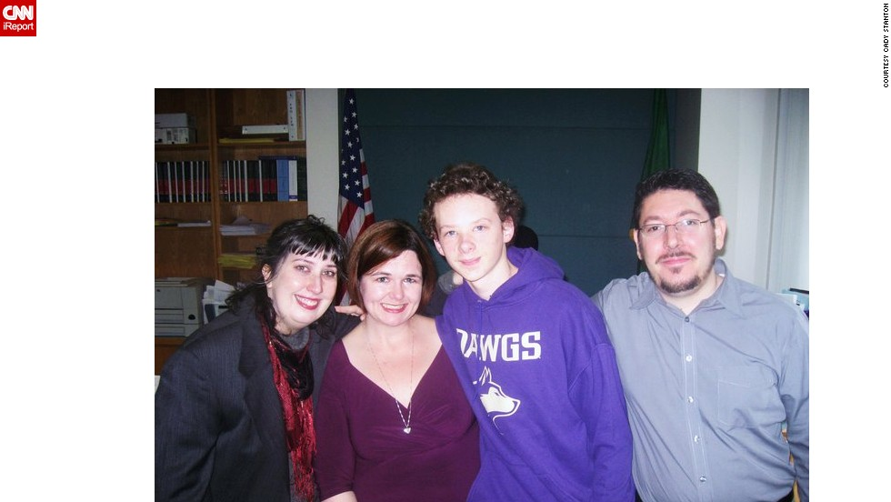 Stanton, second from left, the day the adoption of her son David, middle right, became official in 2010.