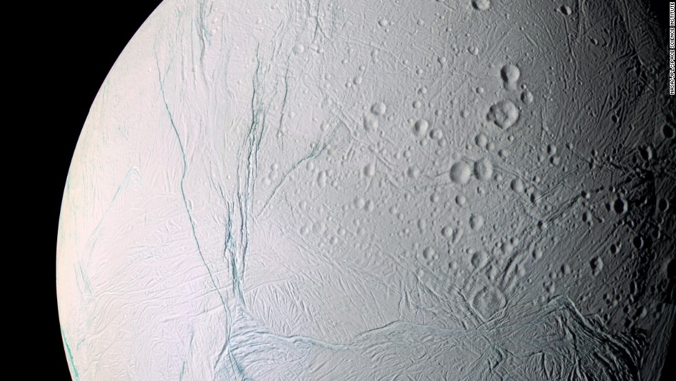 The scars of time and space mark the surface of Saturn's moon Enceladus. Saturn has at least 62 moons in its orbit.