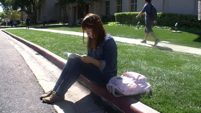 On her school campus, Saira Murillo reads before heading to class.