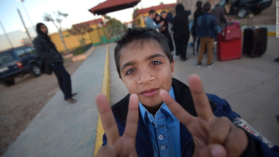 "APRIL 4 - MELILLA, SPAIN: A Syrian refugee shows the victory sign prior to his departure from the Centre for Temporary Stay of Immigrants to make his way to mainland Spain. The U.N. said the<a href=""http://edition.cnn.com/2014/04/03/world/meast/lebanon-syrian-refugees/index.html?hpt=imi_c1""> total number of registered Syrian refugees is 2.58 million</a>."