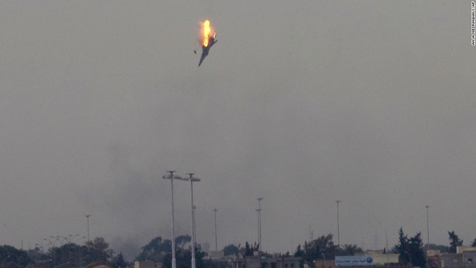 A warplane of Moammar Gadhafi's forces is shot down over the outskirts of Benghazi, Libya, in March 2011.
