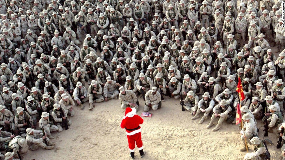 Hundreds of U.S. Marines gather at Camp Commando in the Kuwaiti desert during a Christmas Eve visit by Santa Claus in 2002.