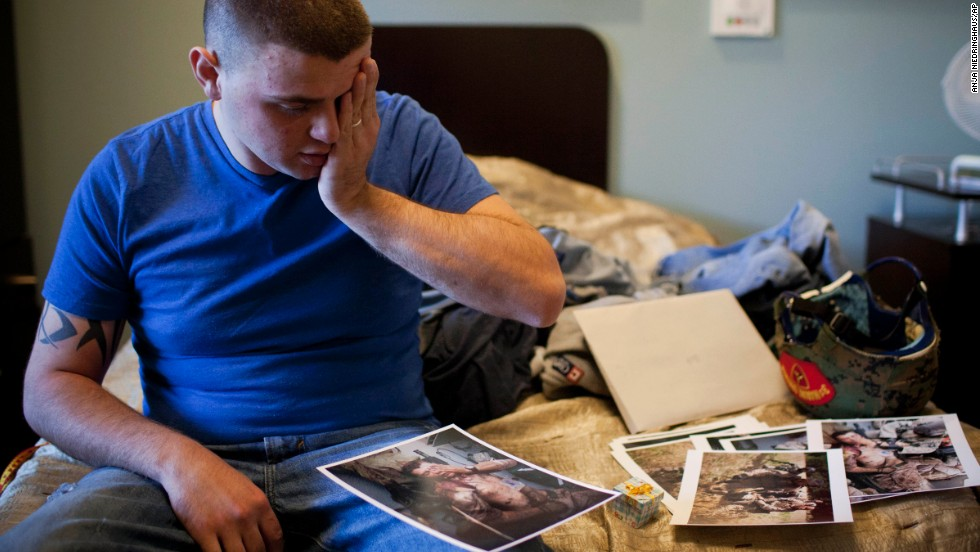 Cpl. Burness Britt, the U.S. Marine from an earlier photo in this gallery, reacts in December 2011 after seeing pictures of his medical evacuation.