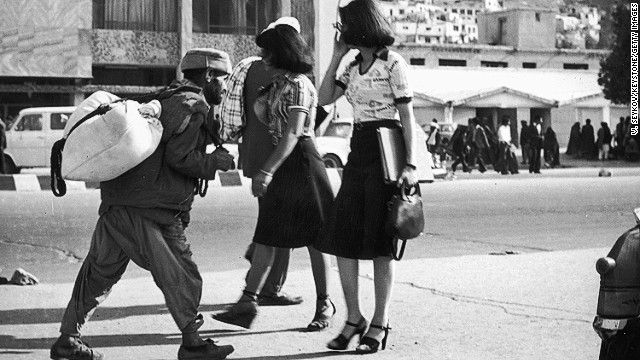 7th June 1978: Women in short skirts and high heels walking freely down a street in Kabul.