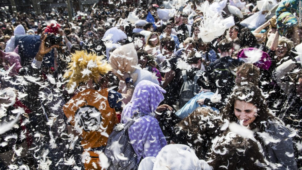A cloud of feathers hangs over those participating in International Pillow Fight Day in Paris on Saturday, April 5. The event takes place in dozens of cities around the world.