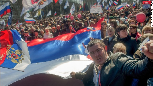 Pro-Russian protesters hold a giant Russian flag during their rally in downtown Donetsk, Ukraine, 06 April 2014. Protesters called for former President Yanukovych's return to Ukraine and to hold a referendum on the status of the Donetsk and Lugansk regions, similar to the recently held referendum in Crimea.
