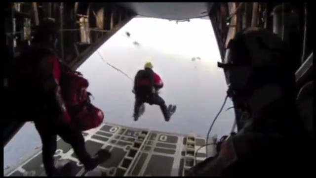 See air rescue team jump from plane