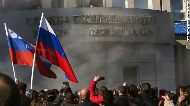 Pro-Russian activists hold a rally in front of Ukraine's regional security service of Ukraine in Lugansk on April 6