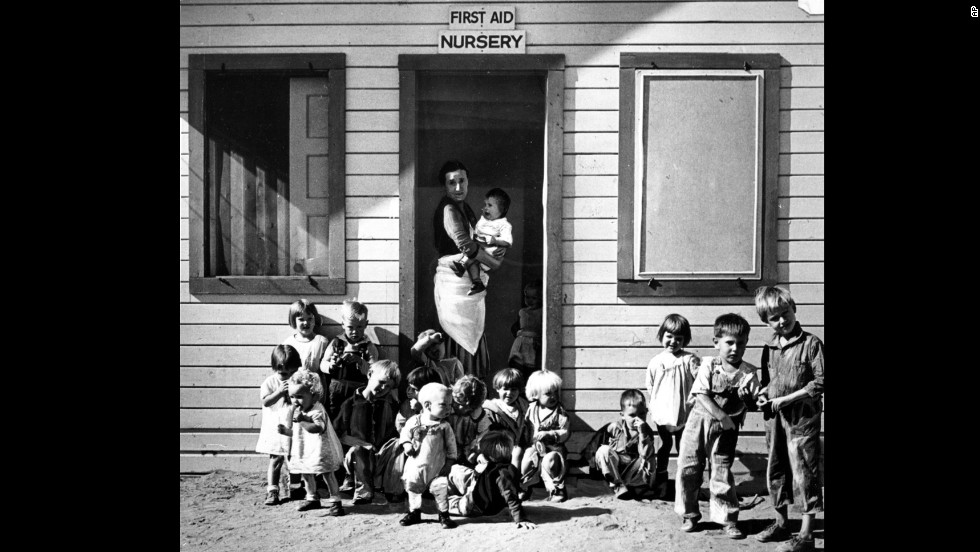 A nurse takes care of children of migratory farm workers in Arvin, California, in 1937. The unemployment rate hovered in the teens. FDR created large-scale public work programs to provide jobs for the poor and middle class.