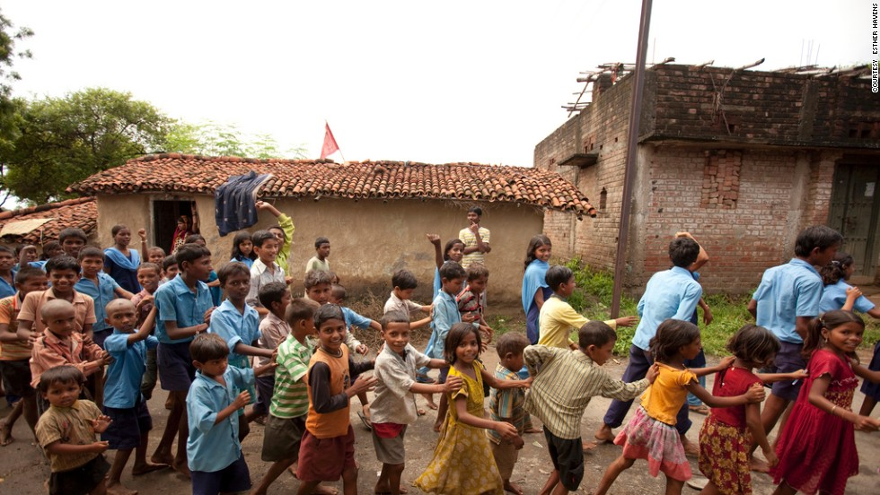 Children march through the streets of Ghorahuan Village, Bihar, singing songs about Albendezole to educate the community about its benefits.