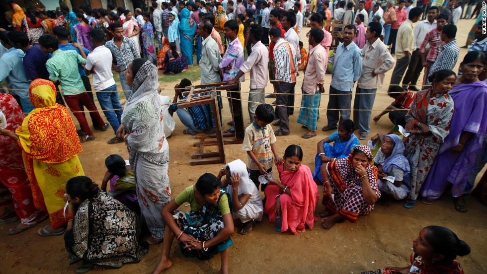People wait in lines to cast their votes in Agartala on April 7.