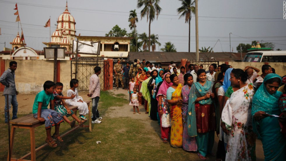 People wait in line to cast their votes during the first phase of voting in Dibrugarh.