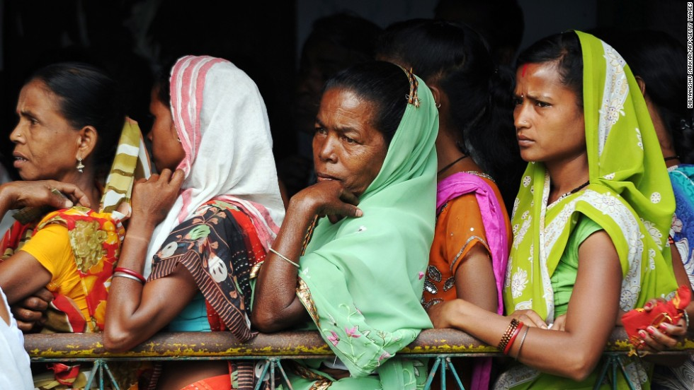 Women voters wait outside a polling station in Dibrugarh on April 7.