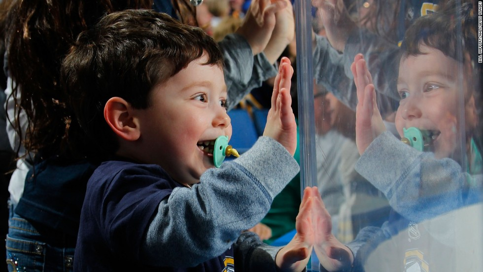 A young fan of the Buffalo Sabres celebrates a Sabres goal during an NHL hockey game Tuesday, April 1, in Buffalo, New York.