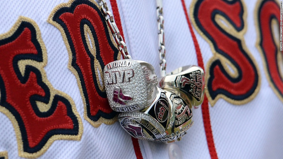 A necklace worn around David Ortiz's neck shows his three World Series rings and the ring he received for being named Most Valuable Player of the 2013 World Series. The Boston Red Sox slugger wore the necklace before his team's home opener Friday, April 4.