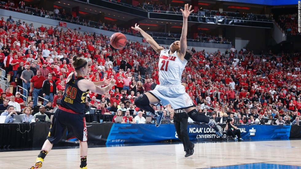 Maryland's Katie Rutan knocks the ball away from Louisville's Bria Smith during their NCAA Tournament game Tuesday, April 1, in Louisville, Kentucky.