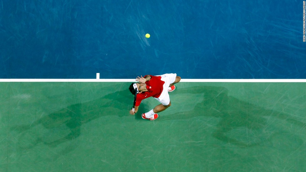 Switzerland's Roger Federer serves the ball to Kazakhstan's Mikhail Kukushkin during a Davis Cup quarterfinal match Friday, April 4, in Geneva, Switzerland.