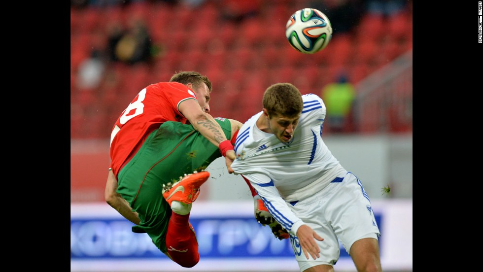 Jan Durica of Lokomotiv Moscow, left, is challenged by Artyom Danilenko of Volga Nizhny Novgorod during a Russian Premier League match Monday, April 7, in Moscow.