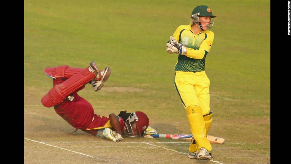 "West Indies cricket player Stefanie Taylor dives but is run out by Australia's Alyssa Healy during a Women's World Twenty20 match Thursday, April 3, in Dhaka, Bangladesh. <a href=""http://www.cnn.com/2014/04/01/worldsport/gallery/what-a-shot-0401/index.html"">See 34 amazing sports photos from last week</a>"