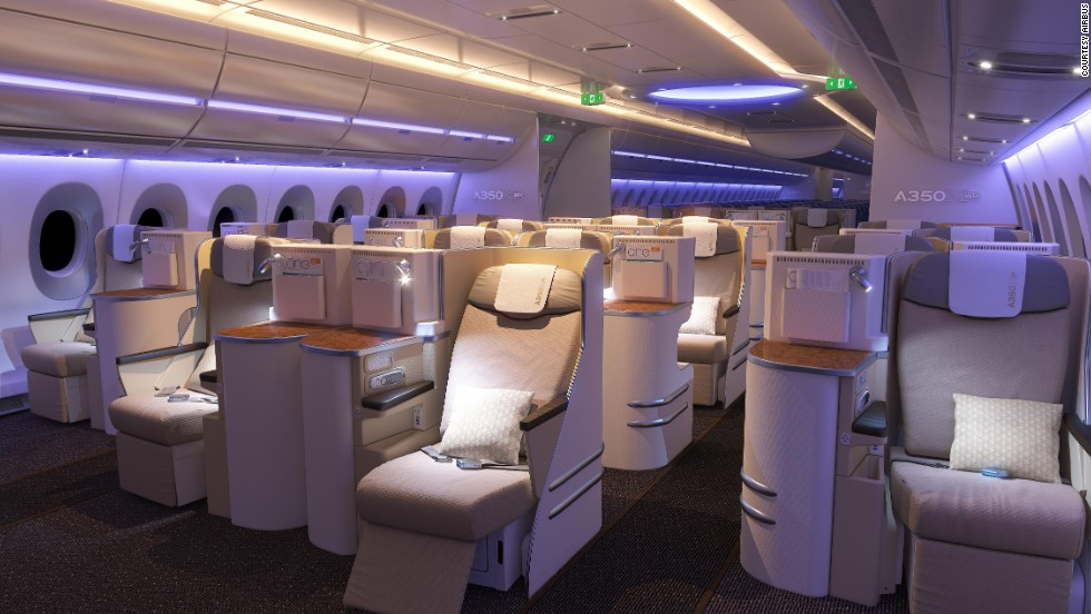 Airbus unveiled the interior cabin on two of its A350 XWB test planes. LED lighting and near-vertical side walls are two of the plane-maker's innovations.