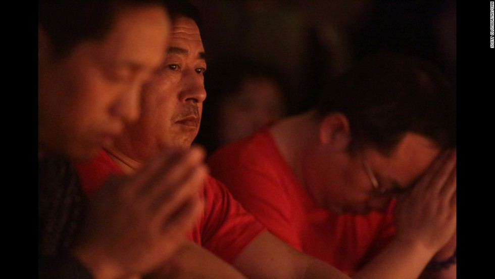 """Families of the MH370 passengers hold a candlelight vigil in Beijing on Tuesday, April 8. They wait in hope for any news on their loved ones one month to the day after MH370 went missing.""  By CNN's Scott Clotworthy."