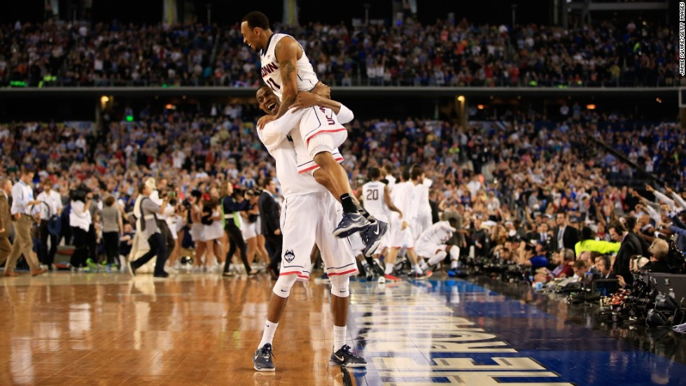 Connecticut guard Ryan Boatright celebrates with a teammate after their victory over Kentucky.