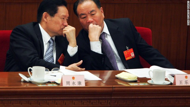 Politburo member Zhou Yongkang (left) and Wang Lequan (right), Communist party secretary of Xinjiang.