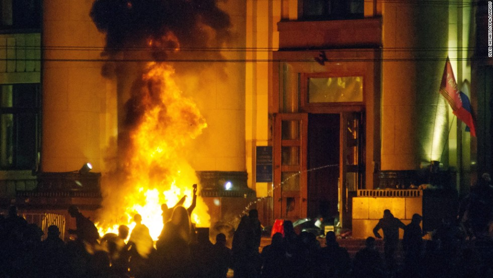 Pro-Russian protesters burn tires near a regional administration building in Kharkiv after police cleared the building on Monday, April 7.