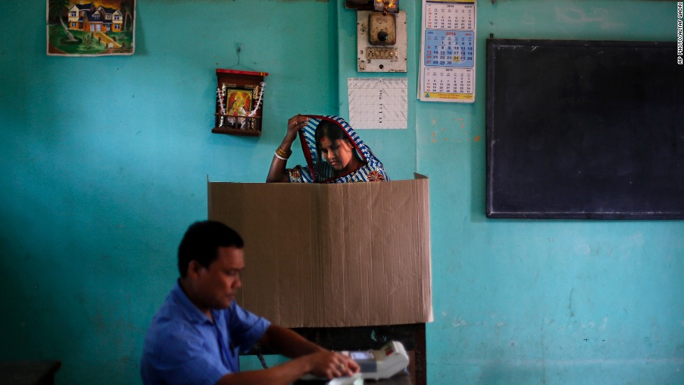 "APRIL 8 - DIBRUGARH, INDIA: A woman casts her vote during the Indian election, the world's biggest poll ever. The country's <a href=""http://edition.cnn.com/2014/04/06/world/asia/india-elections-explainer/index.html?hpt=ibu_c1"">814 million eligible voters will decide</a> between a controversial but popular Hindu nationalist and a member of the Nehru-Gandhi dynasty."