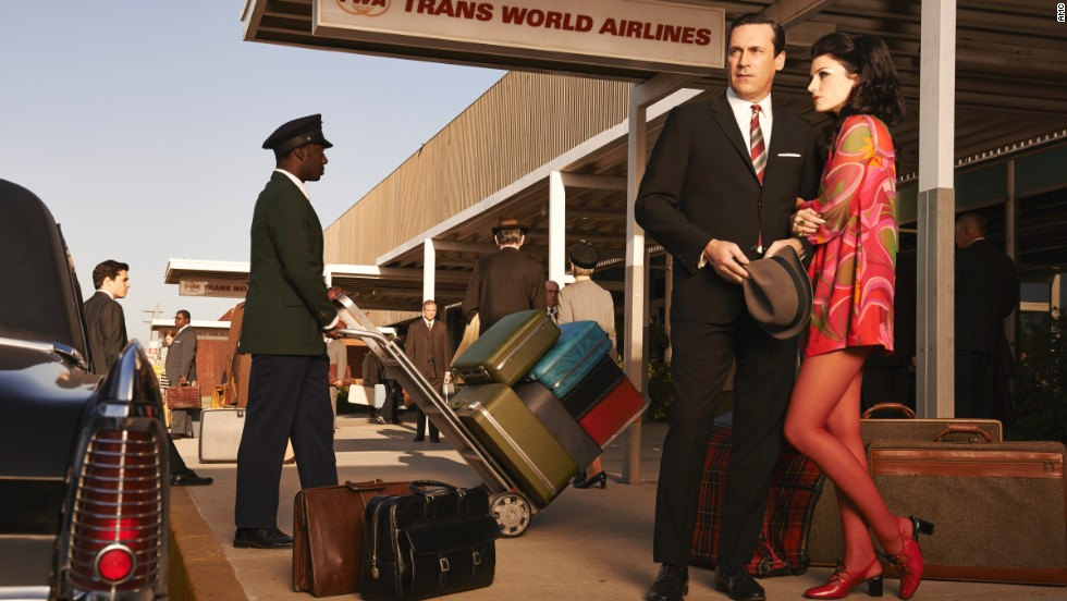 "Don and Megan Draper show up to the airport in fashionably bright colors in this promotional photo for the seventh season. While researching 1960s fashion, Przybyszewski was surprised to find that women's dresses in the late 1960s could be even shorter than Megan's. The money spent on tights and pantyhose worn with these dresses was ""mind-boggling,"" she said."