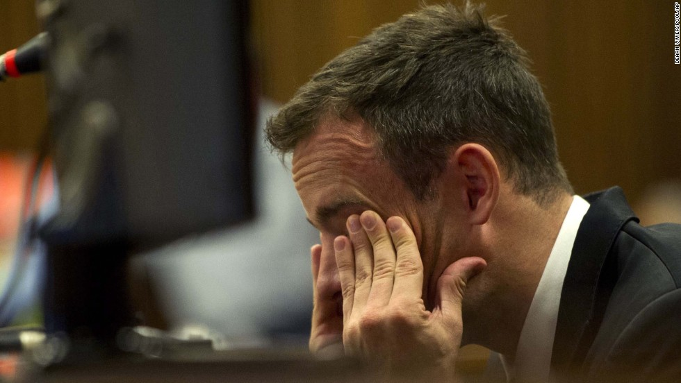 Pistorius rubs his eyes during his trial on April 7.