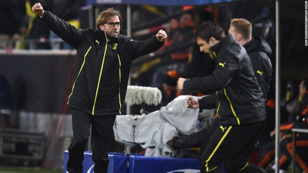 That goal brought Dortmund manager Jurgen Klopp, left, to his feet.