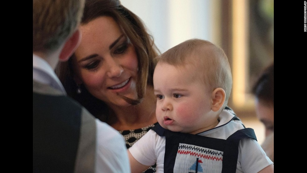 Catherine holds Prince George at a specially convened play group at Government House in Wellington on Wednesday, April 9.