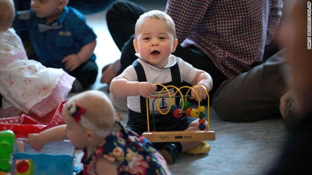 Prince George plays during a visit to Plunket nurse and parents group at Government House on April 9.