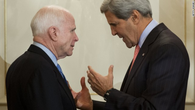 Caption:US Secretary of State John Kerry speaks with US Republican Senator John McCain of Arizona after attending a swearing-in ceremony for new Assistant Secretary of State for European and Eurasian Affairs Victoria Nuland at the State Department in Washington, DC, September 18, 2013. AFP PHOTO / Saul LOEB (Photo credit should read SAUL LOEB/AFP/Getty Images)