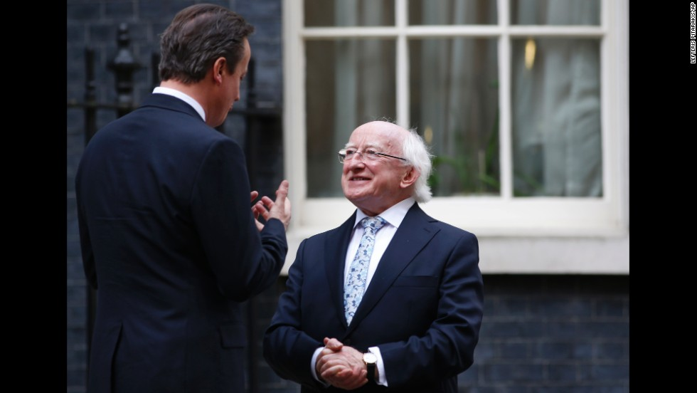 British Prime Minister David Cameron talks with Higgins outside 10 Downing St. in London on Wednesday, April 9.