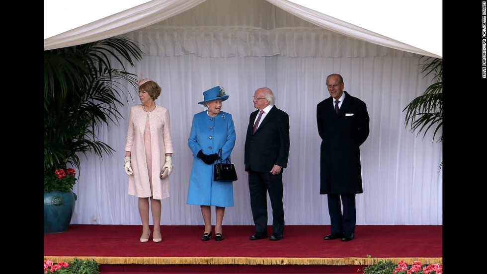 From left, Sabina Higgins, Queen Elizabeth, President Higgins and the queen's husband, Prince Philip, inspect the guard at Windsor Castle on April 8.
