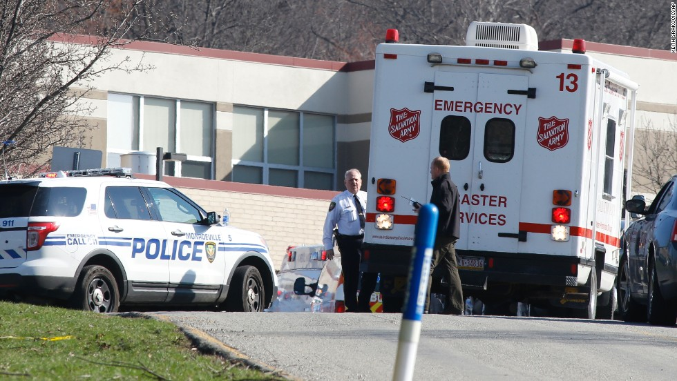 Emergency responders gather in the high school's parking lot.