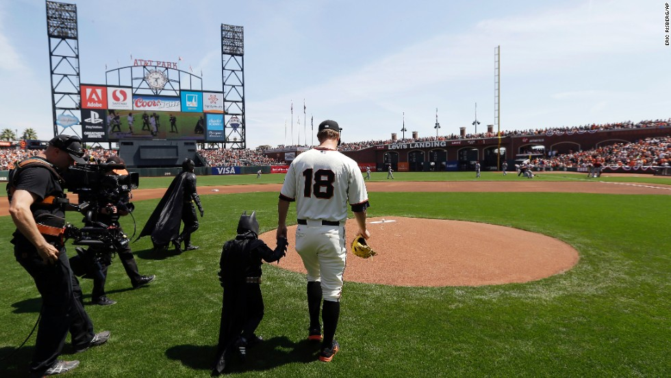 Miles walks to the mound with Giants pitcher Matt Cain.