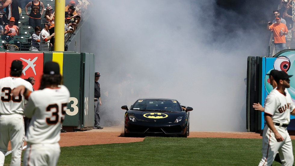 "A ""Batmobile"" drives into San Francisco's AT&T Park with Miles Scott, dressed as Batkid, before he threw out the ceremonial first pitch before the San Francisco Giants' home opener on Tuesday, April 8. Miles, a 5-year-old who has been fighting leukemia since he was a baby, made headlines in November when, through the Make-A-Wish Foundation, <a href=""http://politicalticker.blogs.cnn.com/2013/11/15/obama-has-a-batkid-signal/"">he became Batman for a day</a> and got to ""save"" the city."